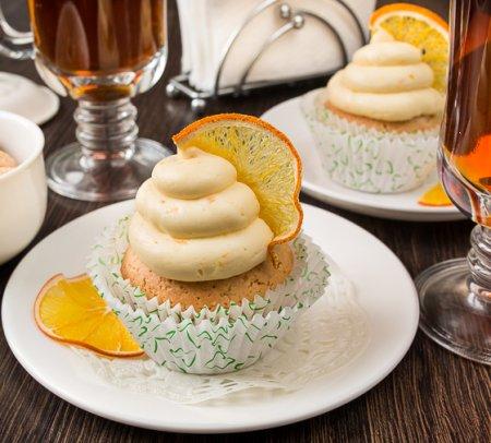 Арахисовые капкейки с медово-апельсиновым кремом